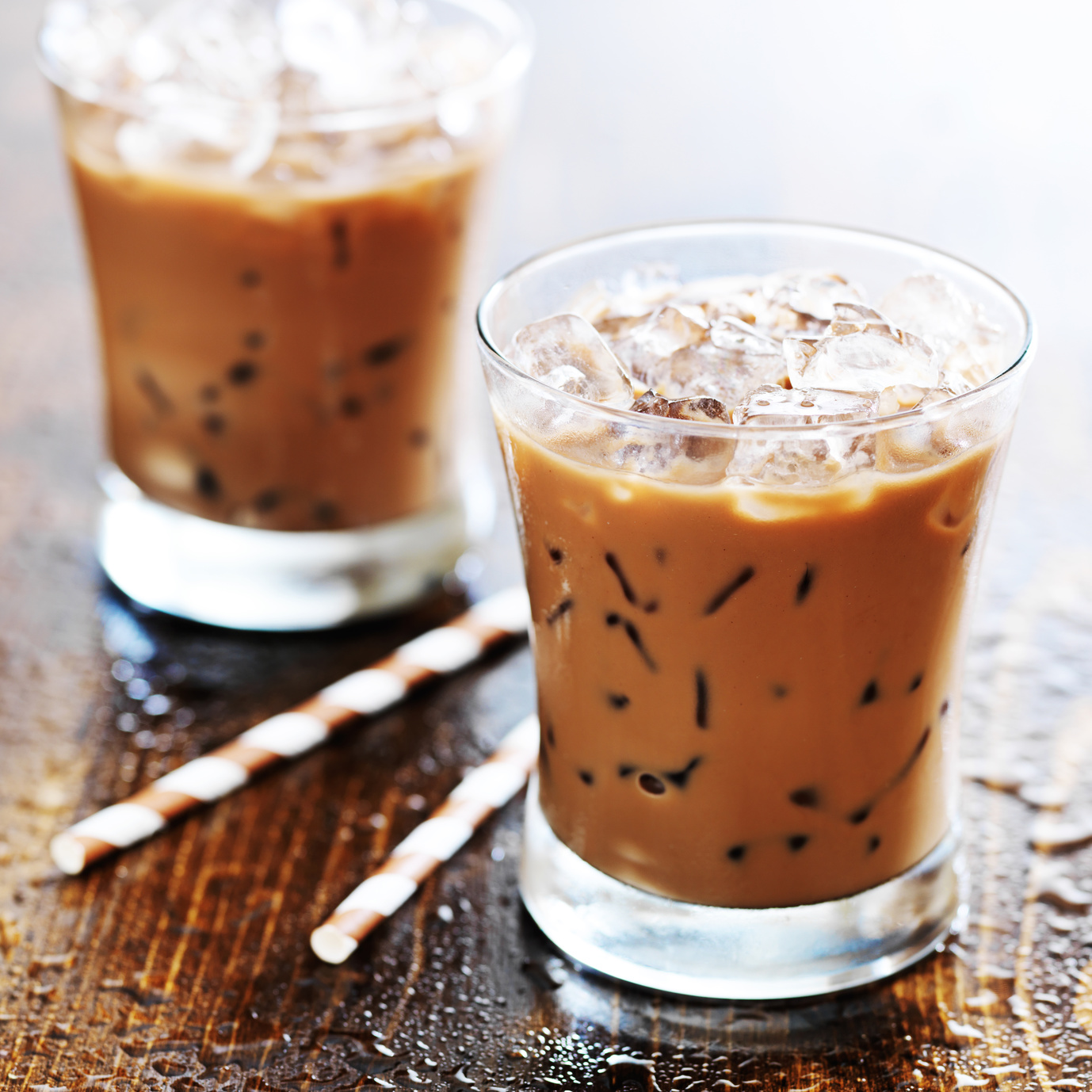 two glasses of iced coffee shot with selective foc us